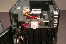 "My HP Microserver naked and open showing the 4 drive bays and the ocz SSD mounted in the 5 1/4"" bay"