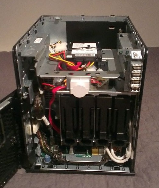 """My HP Microserver naked and open showing the 4 drive bays and the ocz SSD mounted in the 5 1/4"""" bay"""